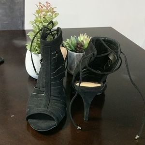 Black slotted heels with ties at the back